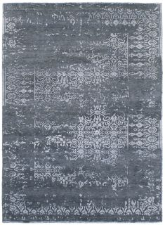 Area rug with abstract design in blue