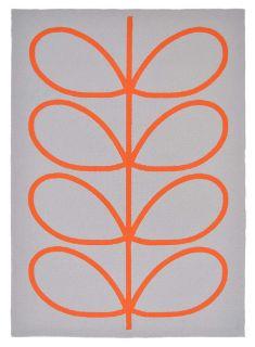 orange indoor/outdoor rug with oversized floral print