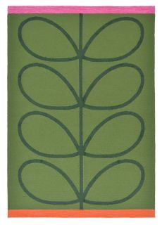 green indoor/outdoor rug with oversized floral print