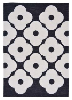 black indoor/outdoor rug with allover floral print