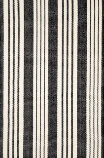 woven cotton rug with black and white stripe