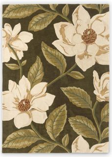 green wool rug with oversized floral design