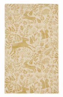 yellow wool rug with a delicate woodland design