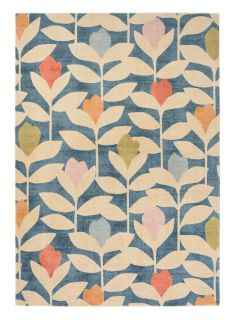 blue wool rug with a simple floral print