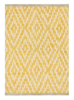 yellow wool rug with repeat aztec design