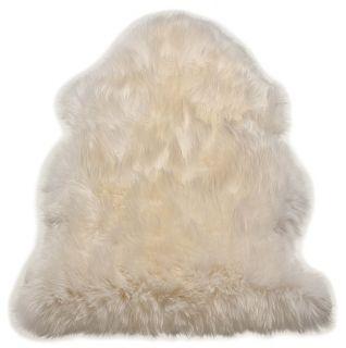 white sheepskin rug