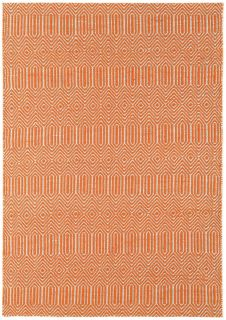 orange and white geometric runner with an aztec pattern