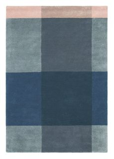 Rectangular rug with pink, grey and blue plaid pattern.