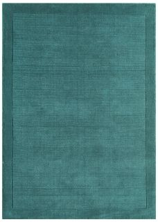 A teal blue rectangle-shaped wool rug with thin border.