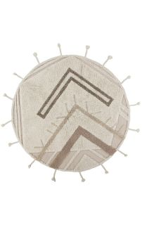 Washable Lorena Canals circle rug with a tribal design in beige
