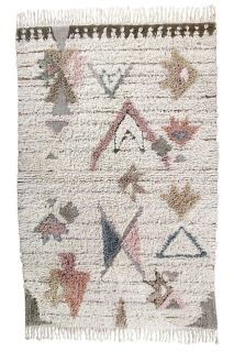 bohemian lorena canals woolable rug with a simple tribal geometric design in blue, pink and beige