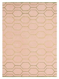 Rectangular pink rug with repeat gold hexagon pattern
